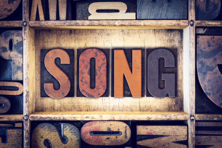chorale: The word Song written in vintage wooden letterpress type.