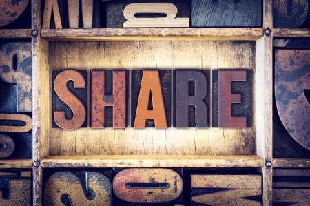 The word Share written in vintage wooden letterpress type.
