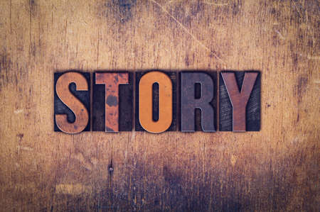 anecdote: The word Story written in dirty vintage letterpress type on a aged wooden background.
