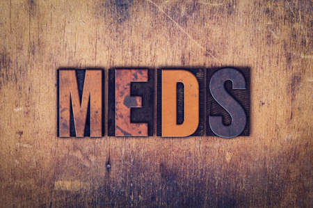 meds: The word Meds written in dirty vintage letterpress type on a aged wooden background. Stock Photo