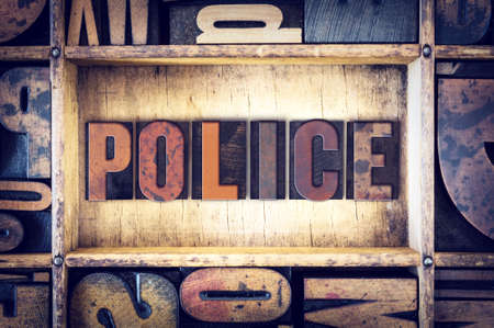 police unit: The word Police written in vintage wooden letterpress type.