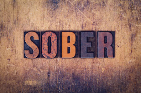 sober: The word Sober written in dirty vintage letterpress type on a aged wooden background. Stock Photo