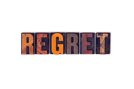 repentance: The word Regret written in isolated vintage wooden letterpress type on a white background. Stock Photo