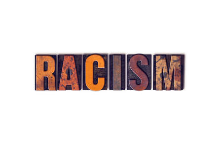 segregate: The word Racism written in isolated vintage wooden letterpress type on a white background. Stock Photo