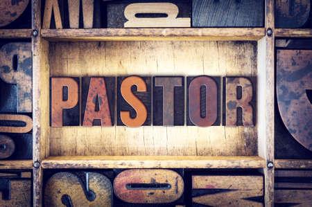 The word Pastor written in vintage wooden letterpress type.