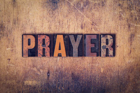 tabernacle: The word Prayer written in dirty vintage letterpress type on a aged wooden background. Stock Photo
