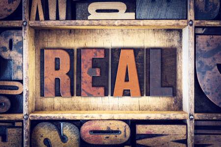 legitimate: The word Real written in vintage wooden letterpress type.