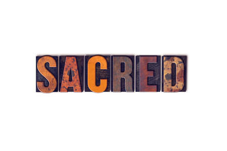 sanctified: The word Sacred written in isolated vintage wooden letterpress type on a white background. Stock Photo