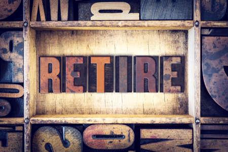retire: The word Retire written in vintage wooden letterpress type.
