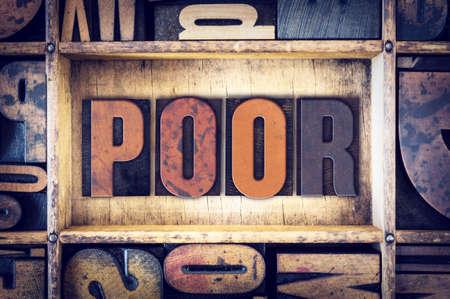 impoverish: The word Poor written in vintage wooden letterpress type. Stock Photo