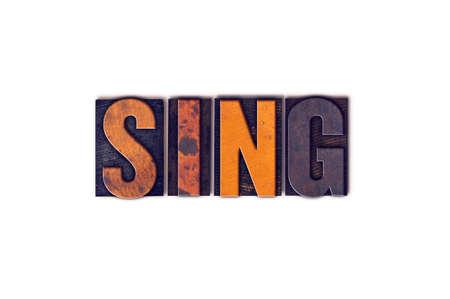 """letras musicales: La palabra """"Sing"""", escrita en el tipo de tipografía aislados cosecha de madera sobre un fondo blanco."""