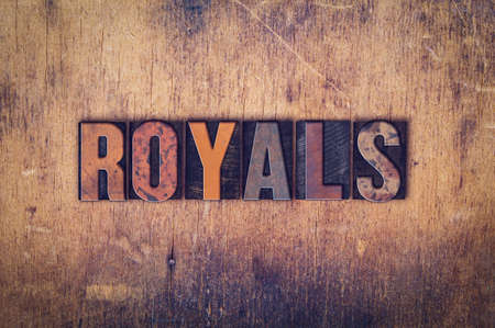 royals: The word Royals written in dirty vintage letterpress type on a aged wooden background.