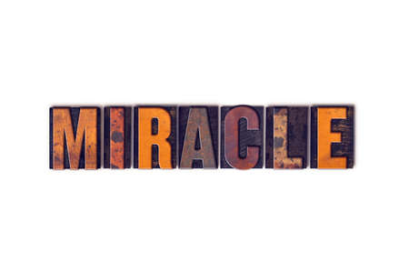 The word Miracle written in isolated vintage wooden letterpress type on a white background.