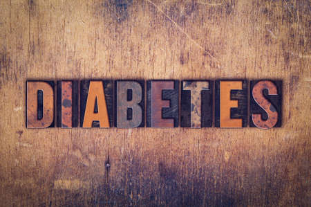 gestational: The word Diabetes written in dirty vintage letterpress type on a aged wooden background. Stock Photo