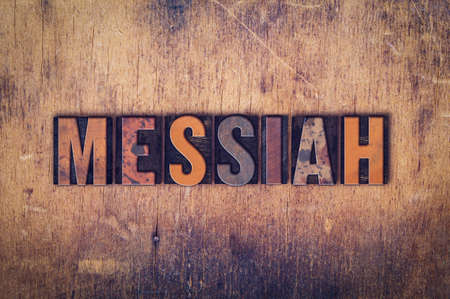 messiah: The word Messiah written in dirty vintage letterpress type on a aged wooden background.