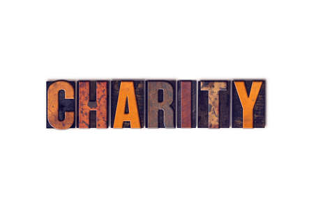 handout: The word Charity written in isolated vintage wooden letterpress type on a white background.