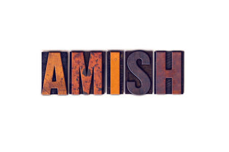 The word Amish written in isolated vintage wooden letterpress type on a white background. Stock Photo