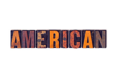 """The word """"American """" written in isolated vintage wooden letterpress type on a white background. Reklamní fotografie"""
