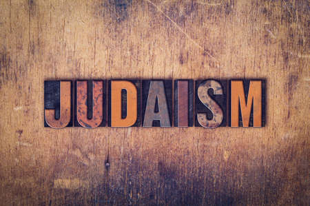 judaism: The word Judaism written in dirty vintage letterpress type on a aged wooden background. Stock Photo