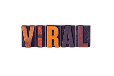 contagious: The word Viral written in isolated vintage wooden letterpress type on a white background.