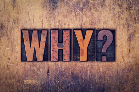 letterpress words: The word Why written in dirty vintage letterpress type on a aged wooden background. Stock Photo