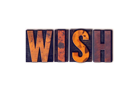 The word Wish written in isolated vintage wooden letterpress type on a white background. Stock Photo