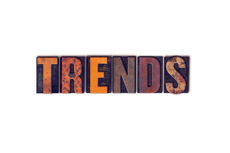 The word Trends written in isolated vintage wooden letterpress type on a white background.