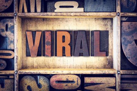 letterpress type: The word Viral written in vintage wooden letterpress type.