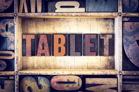 letterpress type: The word Tablet written in vintage wooden letterpress type.