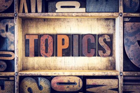 topics: The word Topics written in vintage wooden letterpress type.