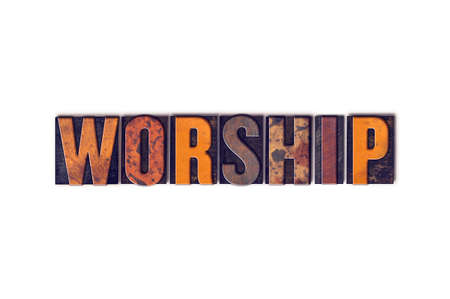 worshipping: The word Worship written in isolated vintage wooden letterpress type on a white background.