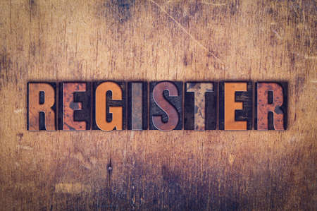 registrar: The word Register written in dirty vintage letterpress type on a aged wooden background. Stock Photo
