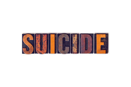 The word Suicide written in isolated vintage wooden letterpress type on a white background.