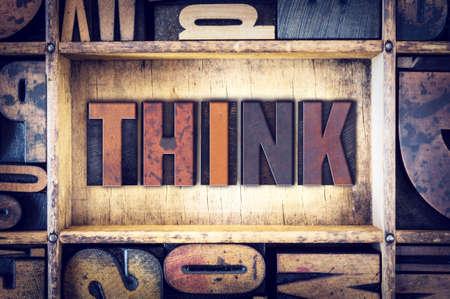 letterpress blocks: The word Think written in vintage wooden letterpress type.