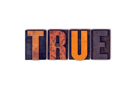 factual: The word True written in isolated vintage wooden letterpress type on a white background. Stock Photo