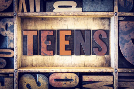 youthfulness: The word Teens written in vintage wooden letterpress type. Stock Photo