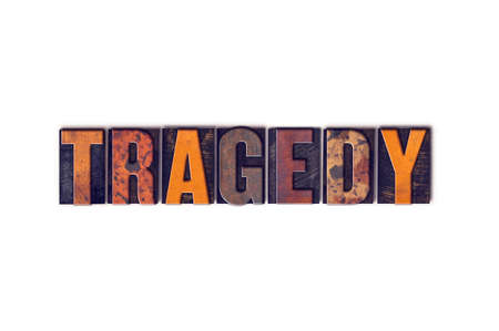 tragedy: The word Tragedy written in isolated vintage wooden letterpress type on a white background.