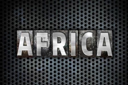 metal grid: The word Africa written in vintage metal letterpress type on a black industrial grid background.