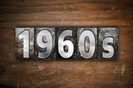sixties: The word 1960s written in vintage metal letterpress type on an aged wooden background. Stock Photo