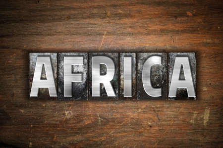 The word Africa written in vintage metal letterpress type on an aged wooden background. Stock Photo