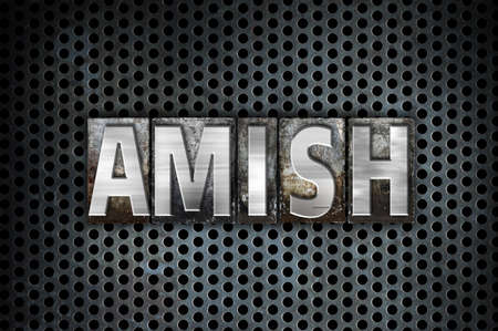 The word Amish written in vintage metal letterpress type on a black industrial grid background.