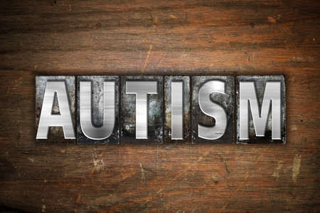 developmental disorder: The word Autism written in vintage metal letterpress type on an aged wooden background. Stock Photo