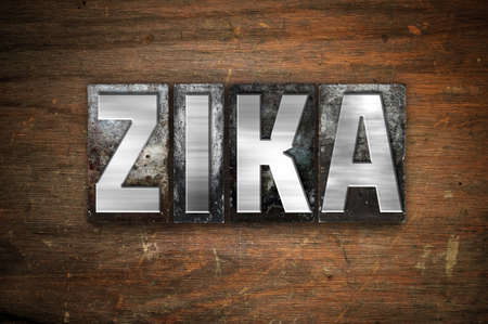 pandemic: The word Zika written in vintage metal letterpress type on an aged wooden background. Stock Photo