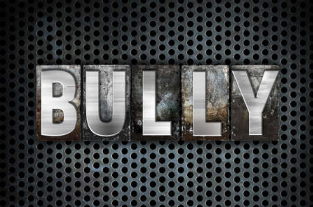 to tease: The word Bully written in vintage metal letterpress type on a black industrial grid background.