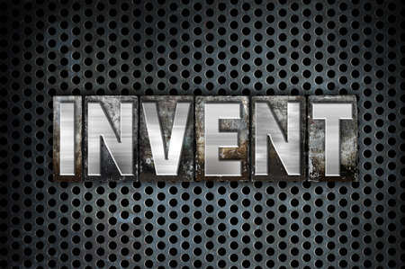 conceive: The word Invent written in vintage metal letterpress type on a black industrial grid background. Stock Photo