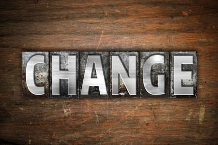 alteration: The word Change written in vintage metal letterpress type on an aged wooden background. Stock Photo