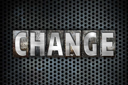 alteration: The word Change written in vintage metal letterpress type on a black industrial grid background. Stock Photo