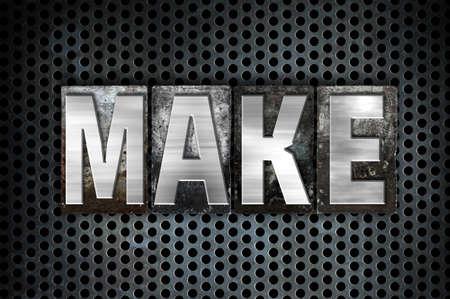 metal grid: The word Make written in vintage metal letterpress type on a black industrial grid background. Stock Photo