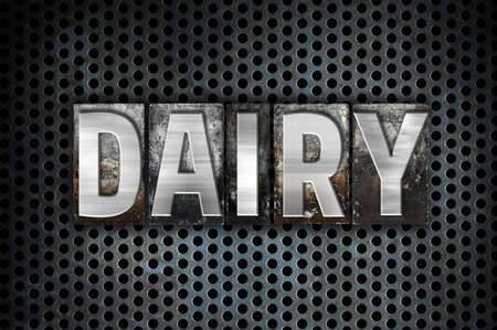 lactose intolerant: The word Dairy written in vintage metal letterpress type on a black industrial grid background.
