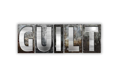 guilt: The word Guilt written in vintage metal letterpress type isolated on a white background.